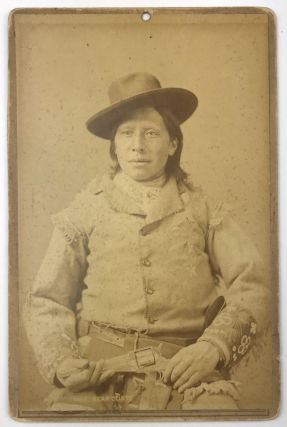 Cabinet Card of Bear Coat, a Sioux Scout, Holding a Colt Revolver]. F. Jay Haynes